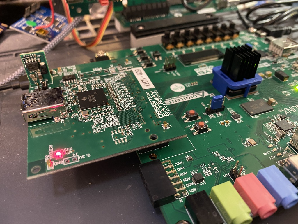 the USB3FMC carrier board is mounted atop another FPGA board